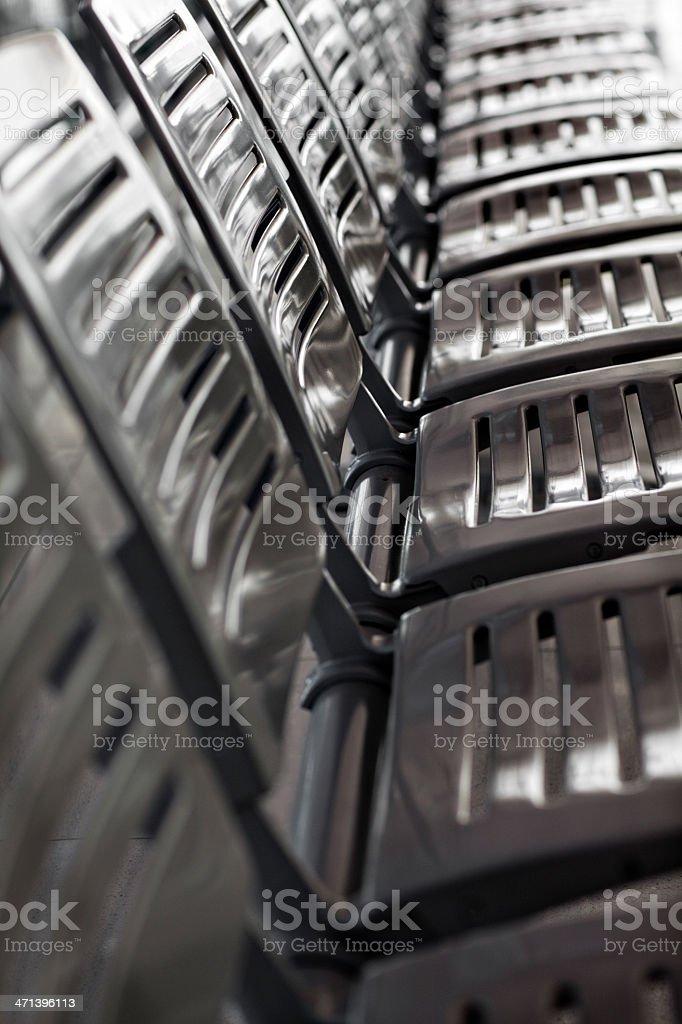 Aluminium seats in a row stock photo