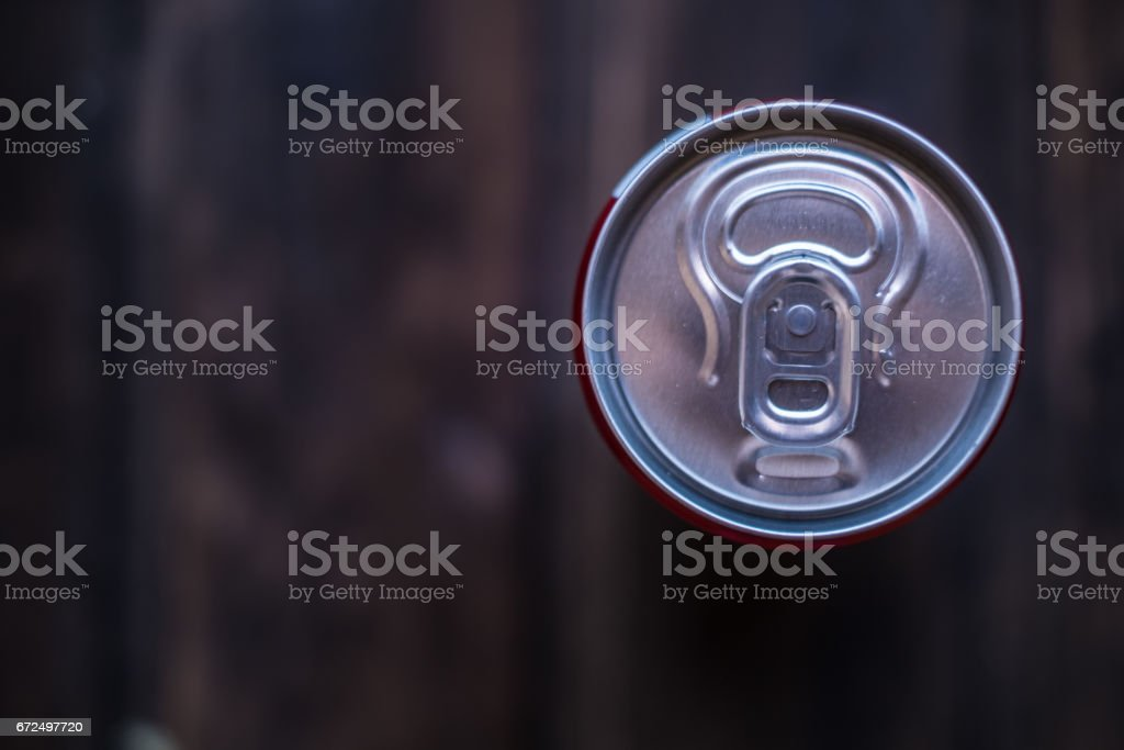 Aluminum can with vintage wooden  background and a space for text stock photo