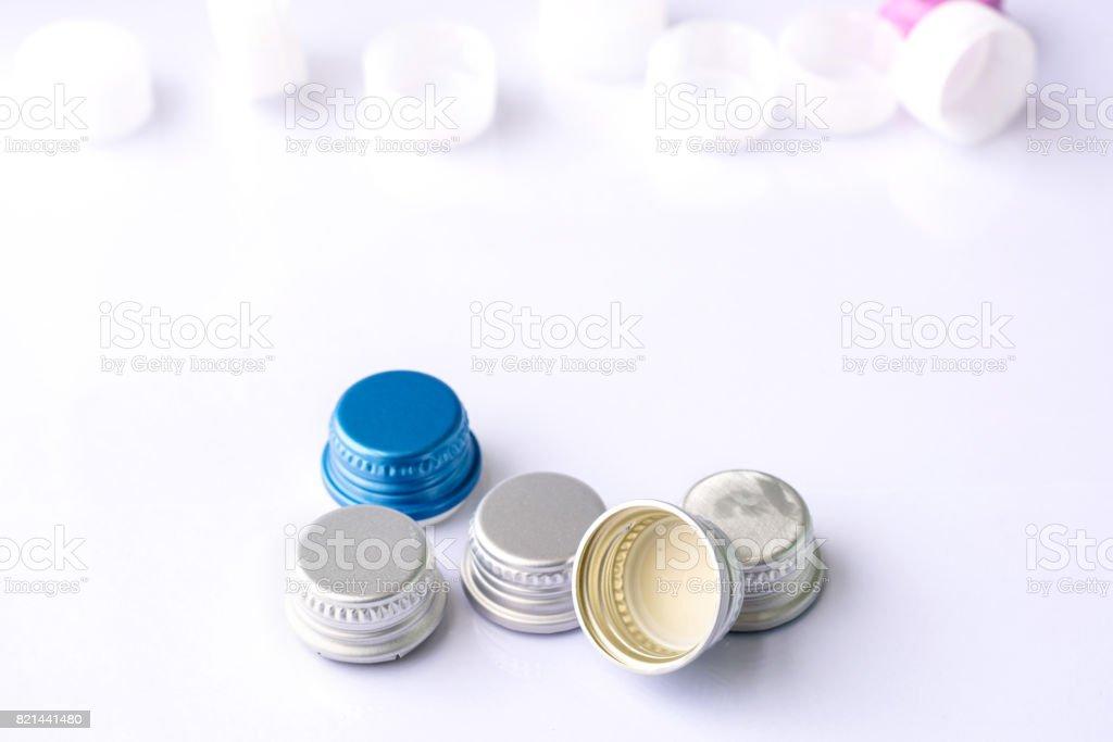 Aluminum closures for bottle on white background stock photo