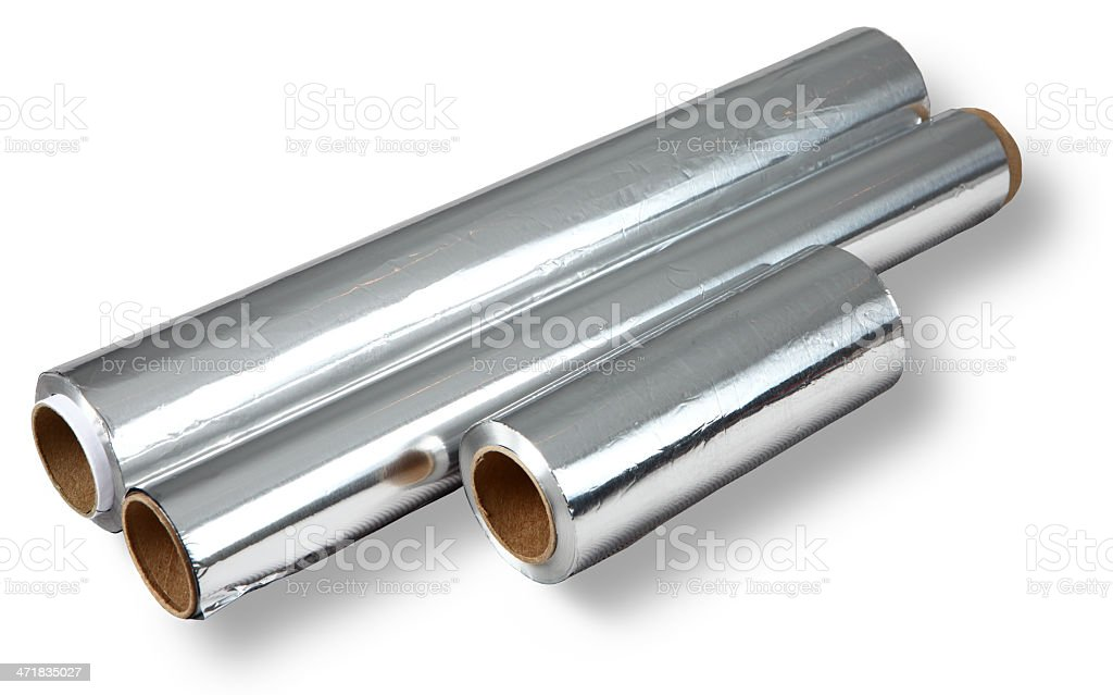 Aluminum foil for cooking and storing food, four rolls. stock photo
