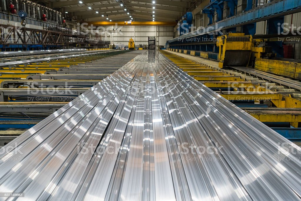 Aluminum lines on a conveyor belt in a factory stock photo