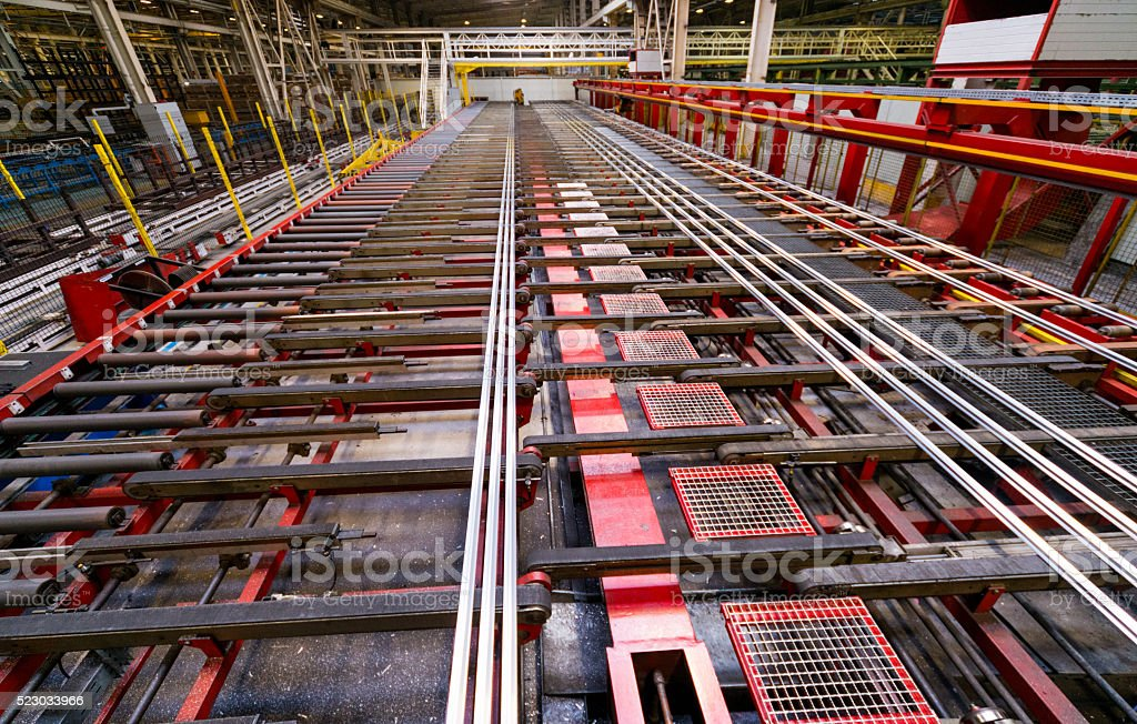 Aluminum lines on a conveyor belt in a factory. stock photo