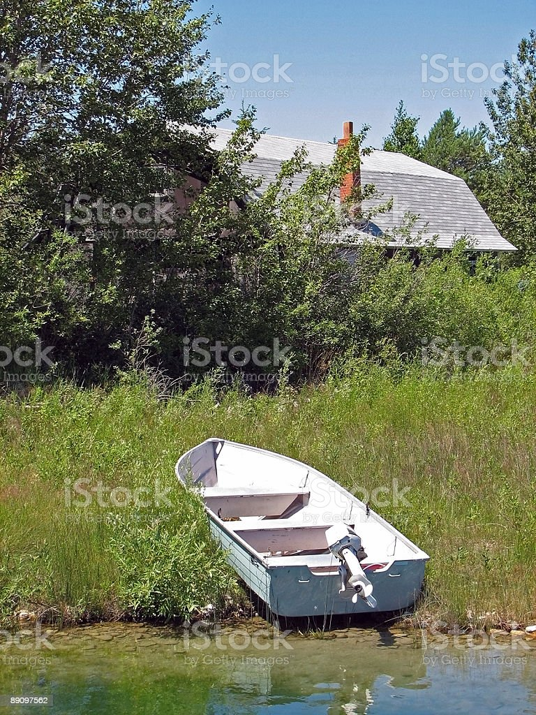 Aluminum Rowboat Pulled up onto Shore royalty-free stock photo