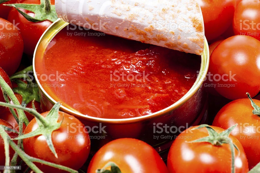 Aluminum tin can and tomato stock photo