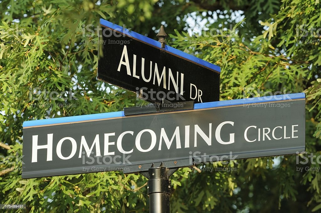 Alumni and homecoming street signs close up stock photo