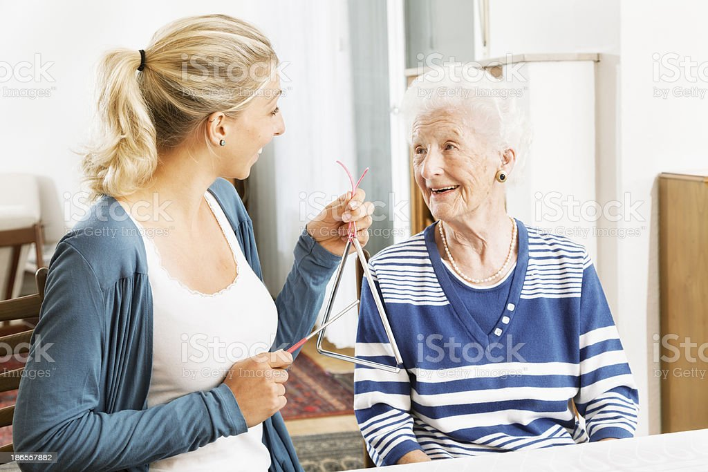 Alzheimer therapy senior woman musical instrument stock photo