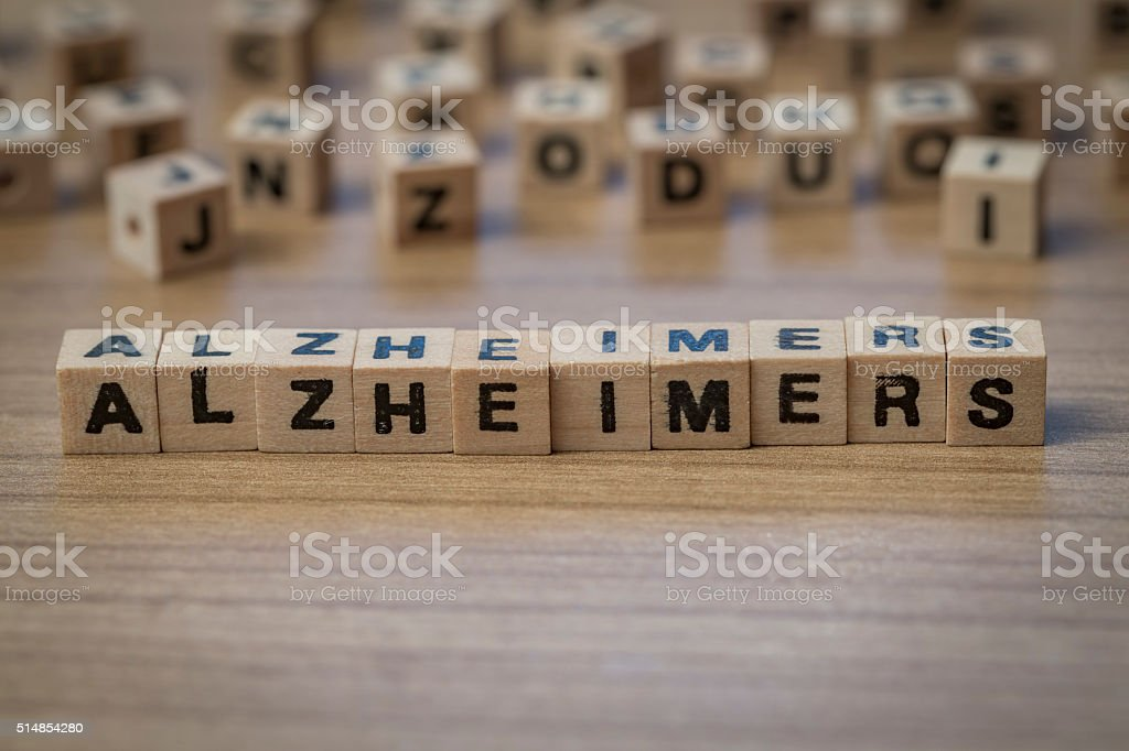 Alzheimers written in wooden cubes stock photo