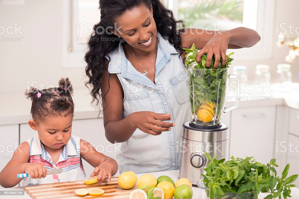I am a big girl by helping mommy! stock photo