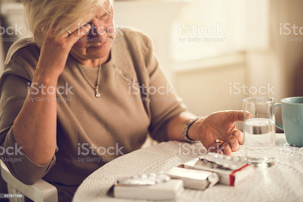 I am going to take a painkiller for my headache! stock photo