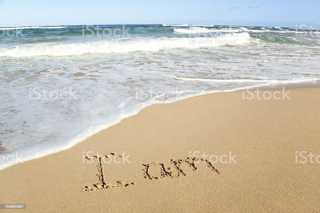 'I am' in the sand beach stock photo