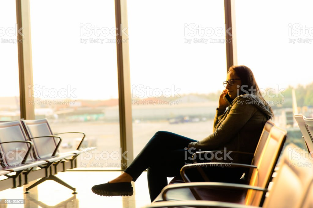 I am running late, the flight seems to be delayed stock photo