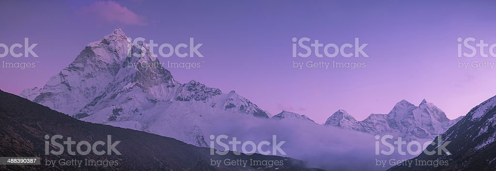 Ama Dablam peak and purple sunset in Himalayas stock photo