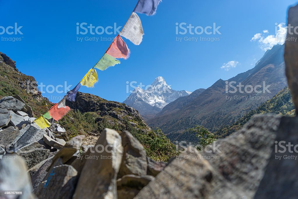 Ama Dablam with stack stone and prayer flag stock photo