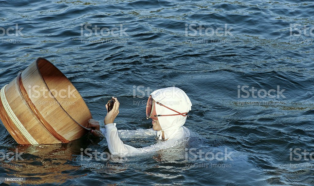 Ama with floating basket stock photo