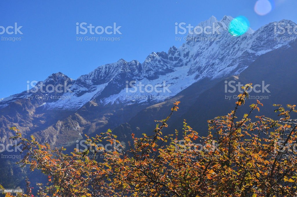 amadablam and sulight flare from everest trek stock photo