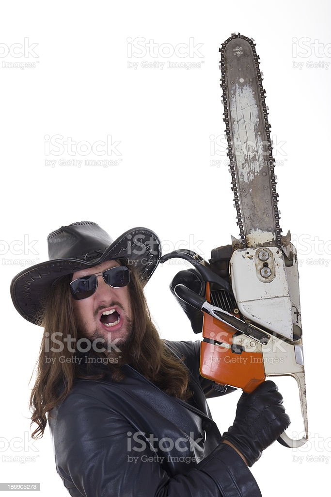 aman holding chainsaw with an expression royalty-free stock photo