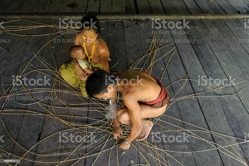Aman Sazali making a rattan basket. stock photo