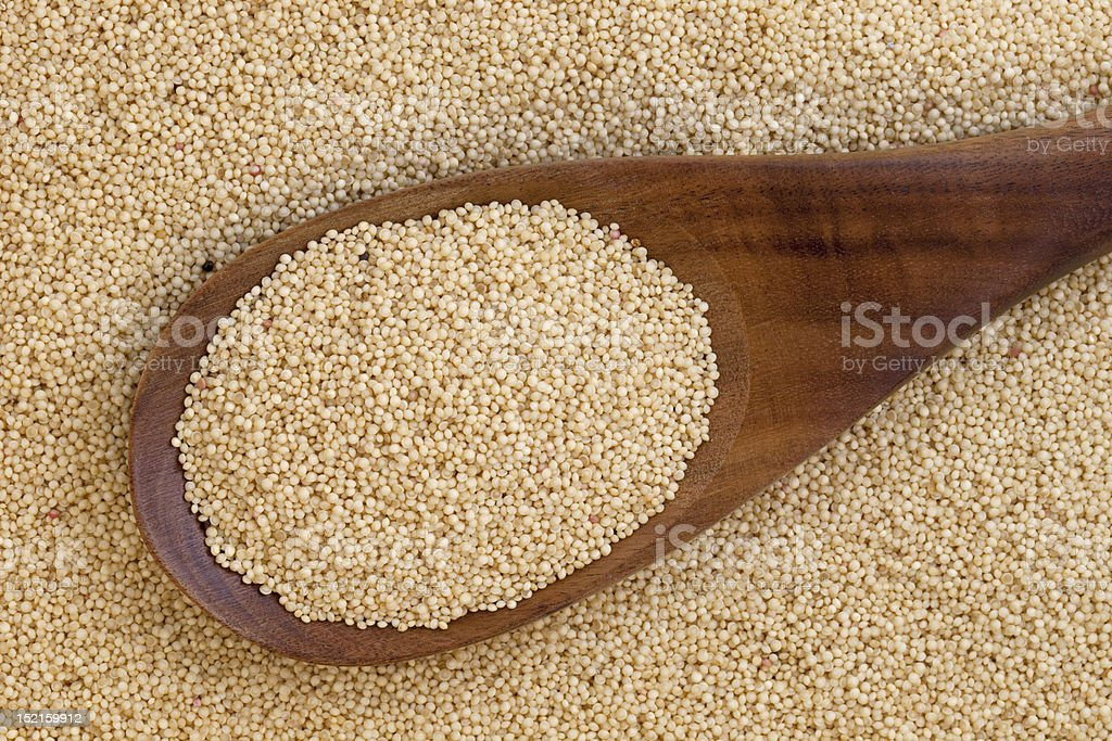 amaranth grain and spoon stock photo