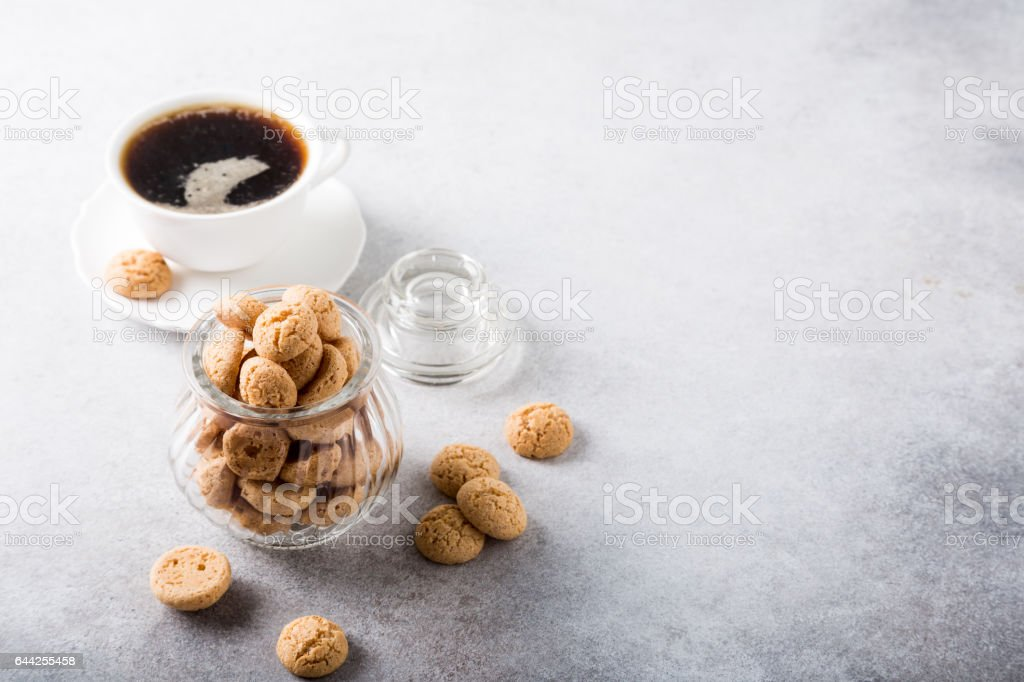 Amaretti cookies with white cup of coffee stock photo