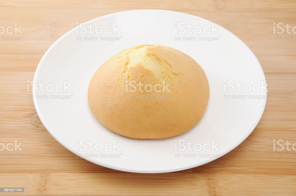 amashoku japanese biscuit scone bread on plate on table cutting board stock photo