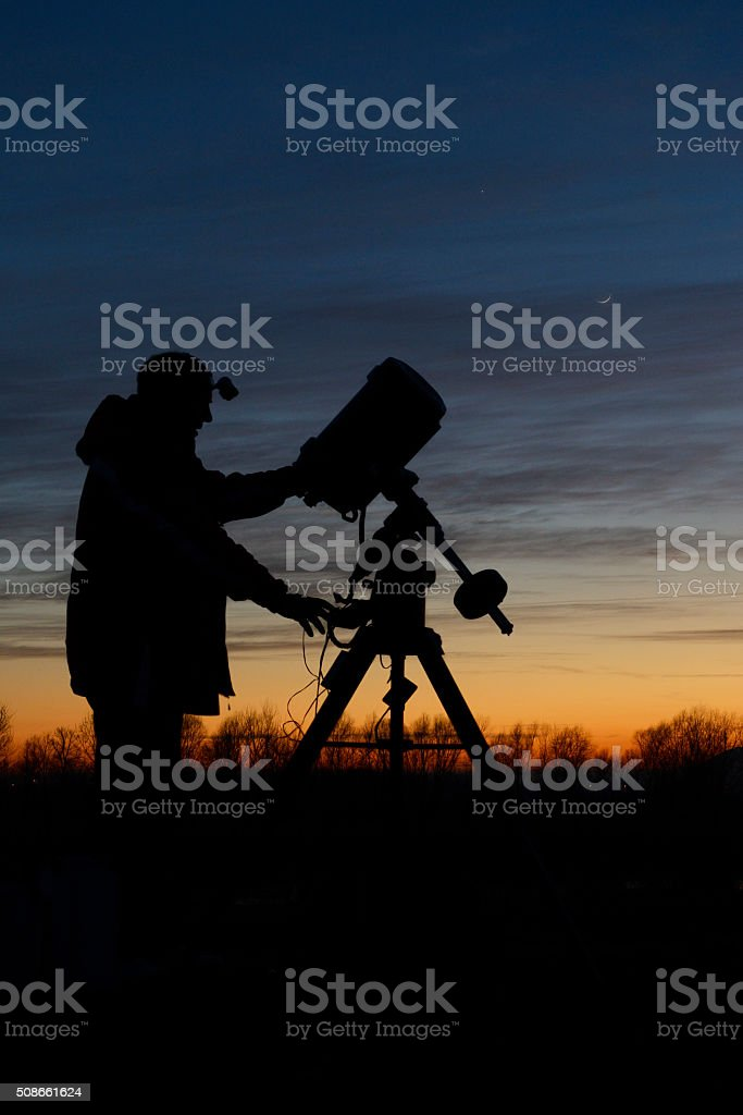 Amateur astronomer with his telescope stock photo