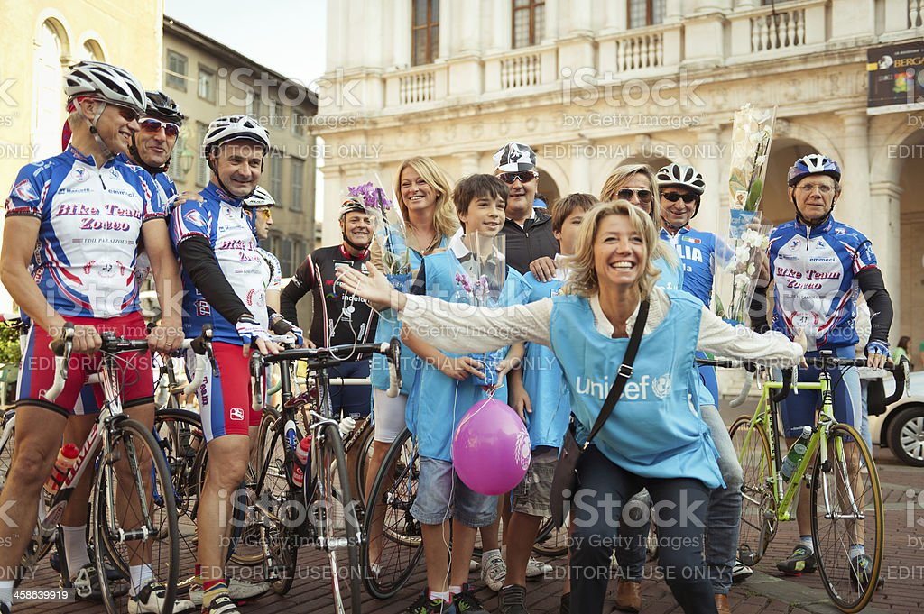 Amateur ciclists and Unicef volunteers in Bergamo, Italy stock photo