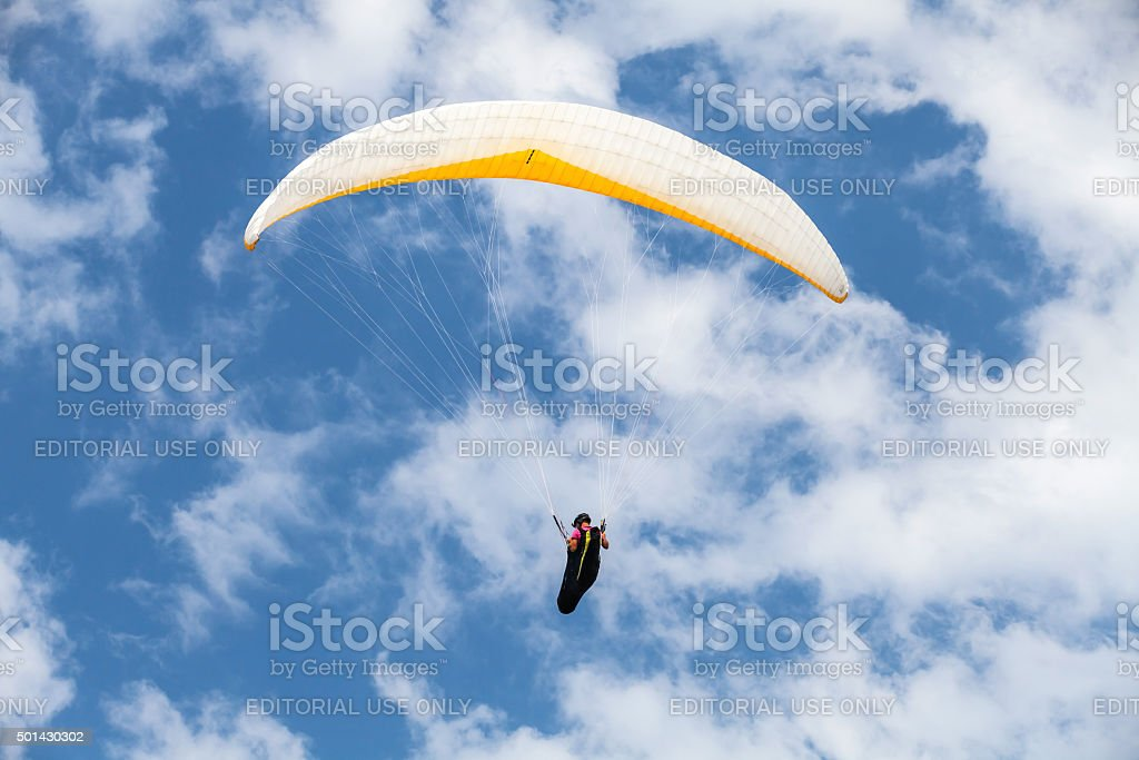 Amateur paraglider in blue cloudy sky stock photo