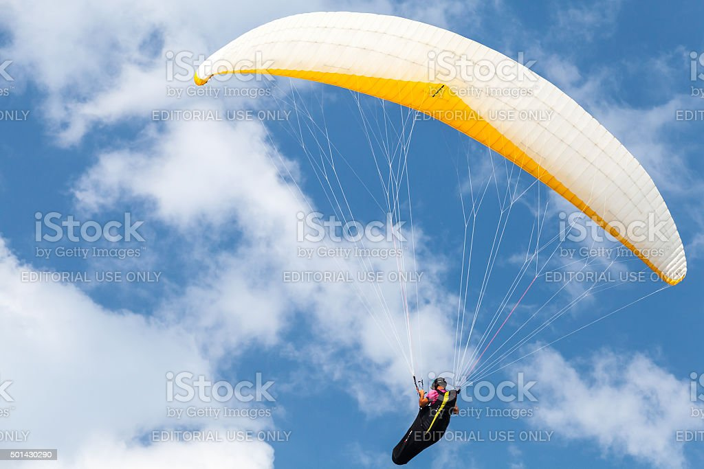 Amateur paraglider in blue sky with clouds stock photo