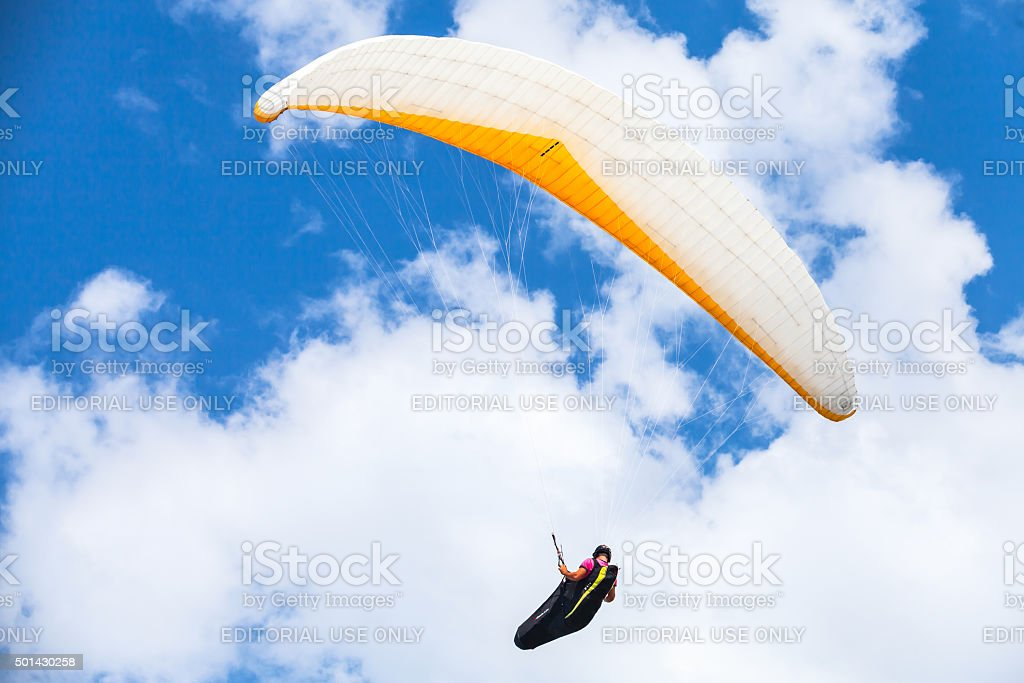 Amateur paraglider in the blue sky stock photo