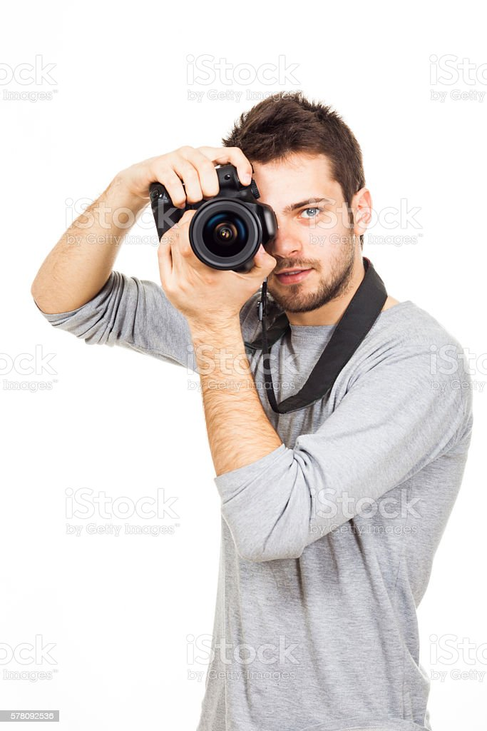 Amateur photographer is ready for a shot stock photo