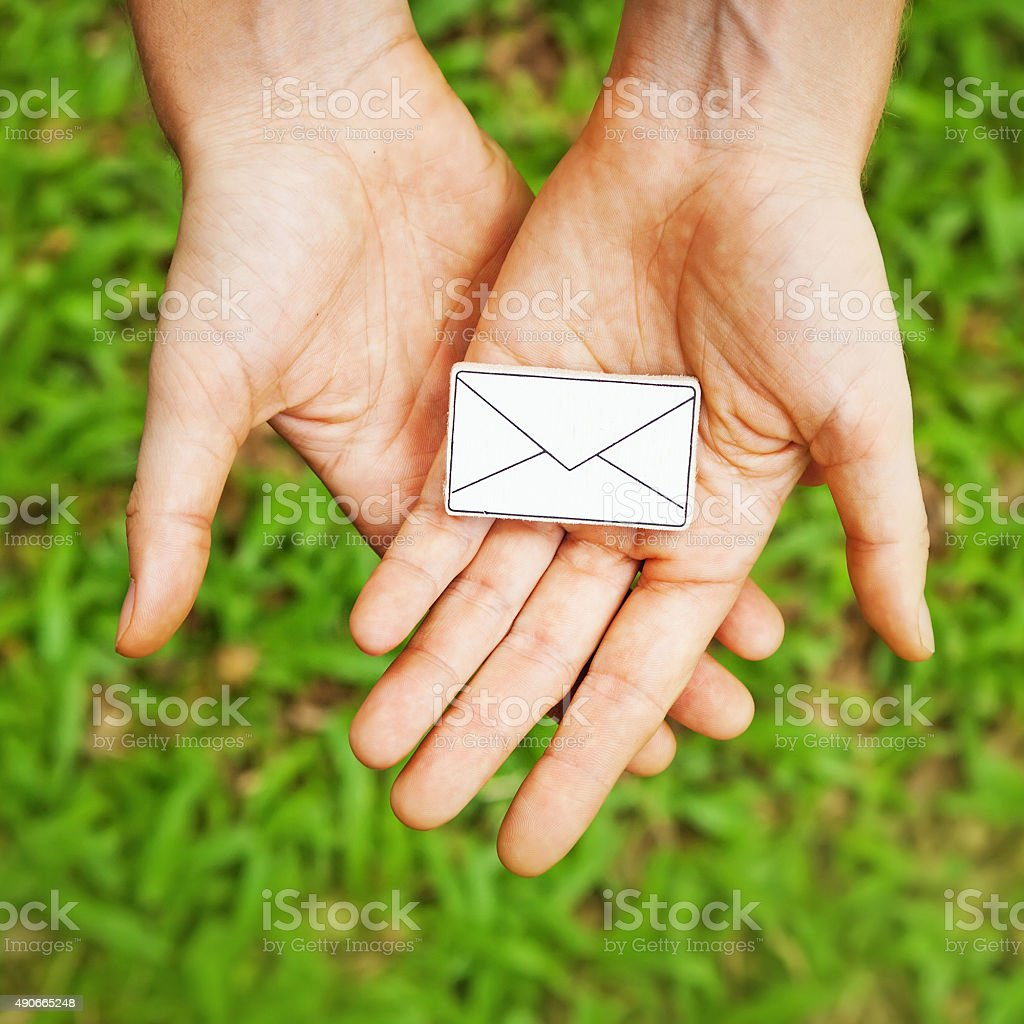 amateur style photo of 'letter' symbol  in two hands stock photo