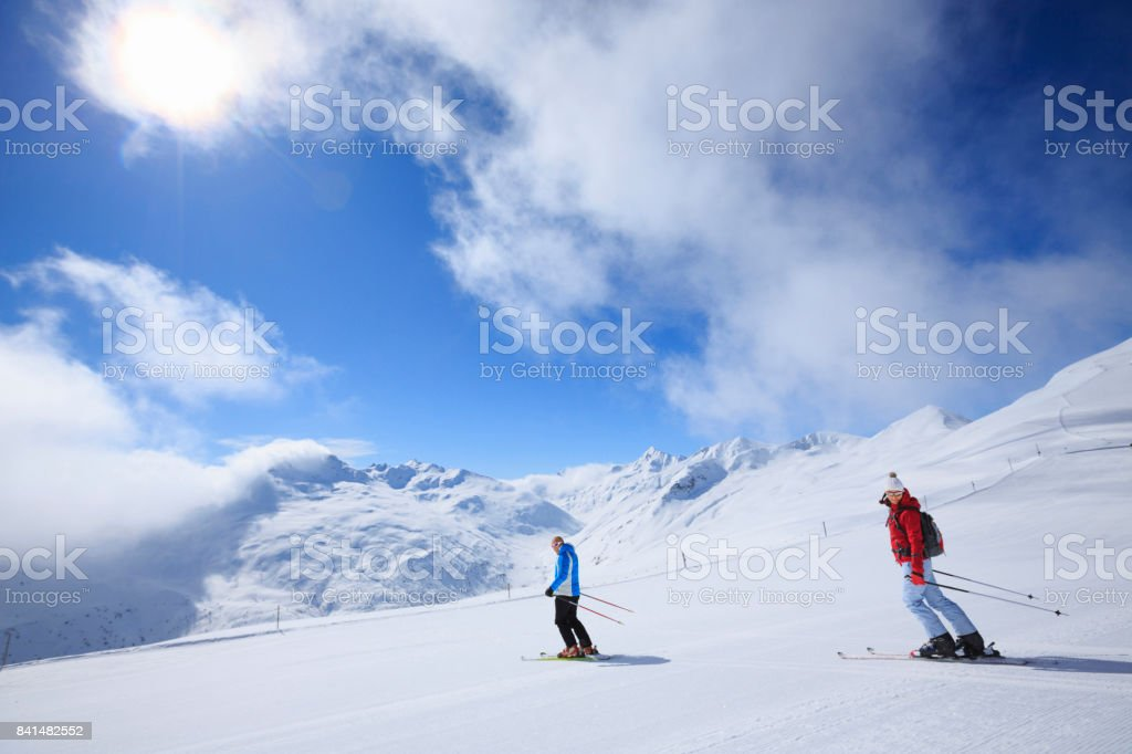 Amateur Winter Sports alpine skiing. Best friends men and women, snow...
