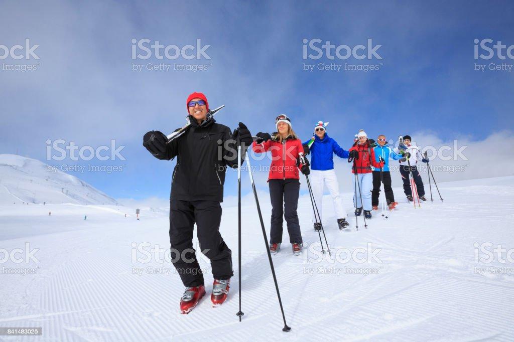 Amateur Winter Sports alpine skiing. Group of skiers. Best friends...
