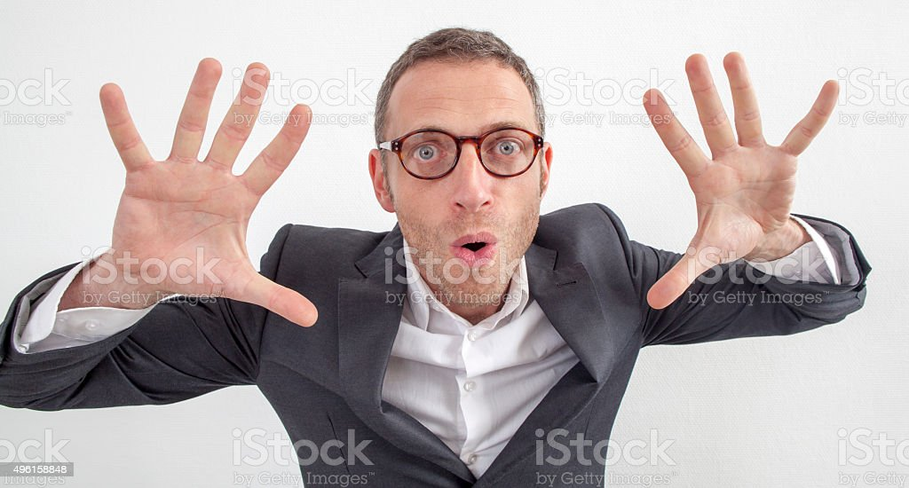 amazed 40s manager holding both hands up for company surprise stock photo
