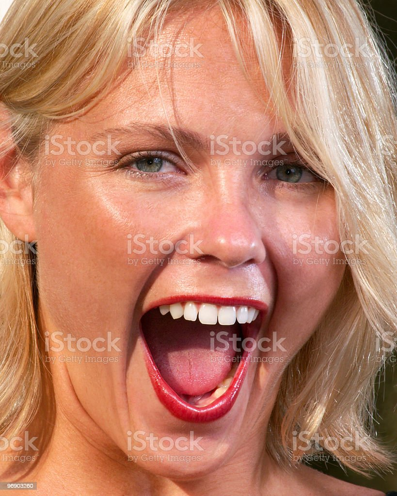Amazed beautiful young blond woman with open mouth royalty-free stock photo