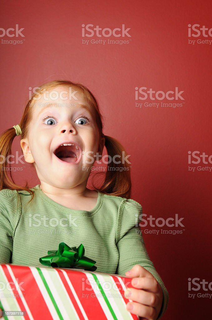 Amazed Little Girl with Christmas Present royalty-free stock photo