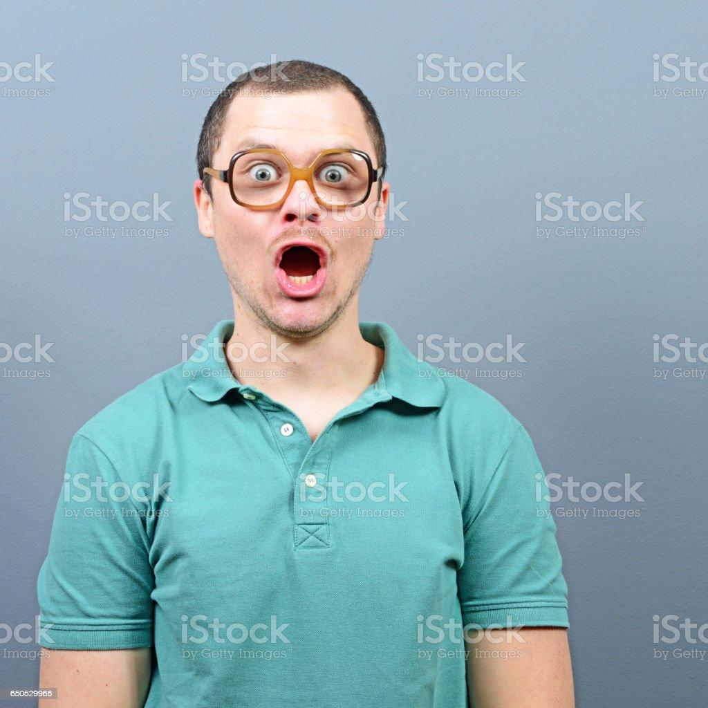 Amazed man having reaction about something stock photo