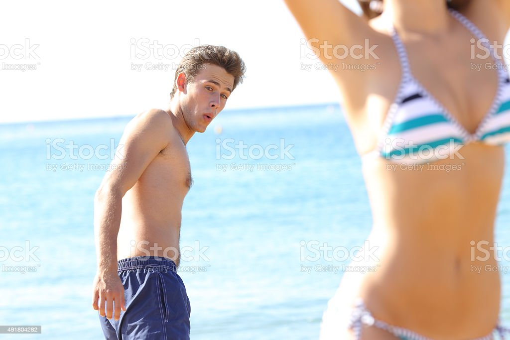 Amazed man looking at woman sexy body stock photo