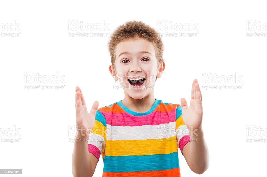 Amazed or surprised child boy showing large size stock photo