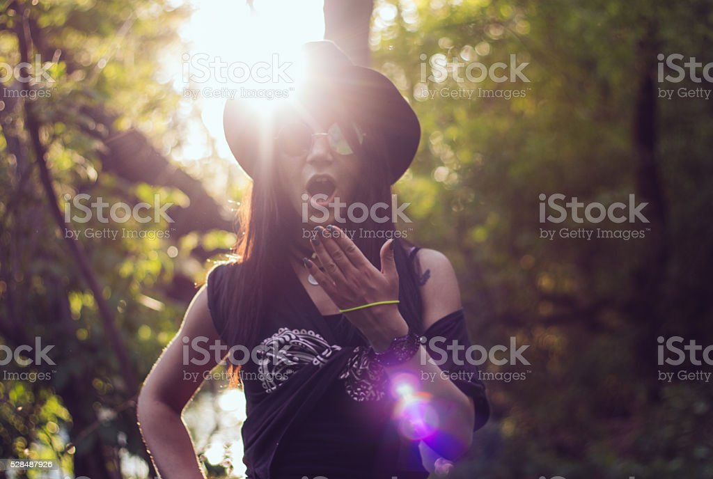 Amazed stylish young girl in green scenery stock photo