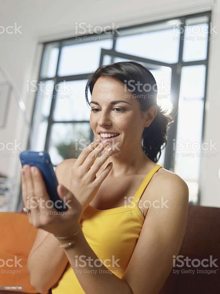 amazed woman holding cellphone royalty-free stock photo