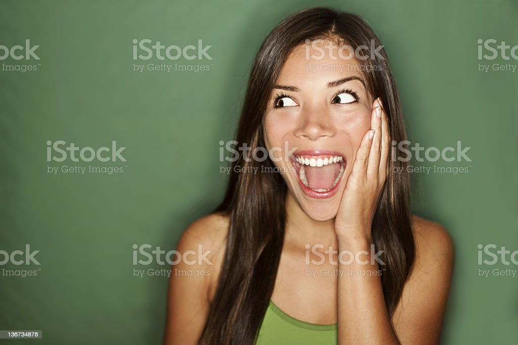 amazement - woman excited looking to the side stock photo