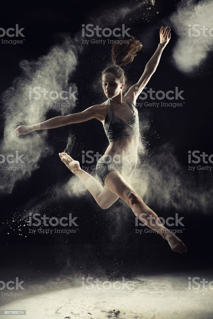 Amazing ballet dancer dancing in powder snow stock photo