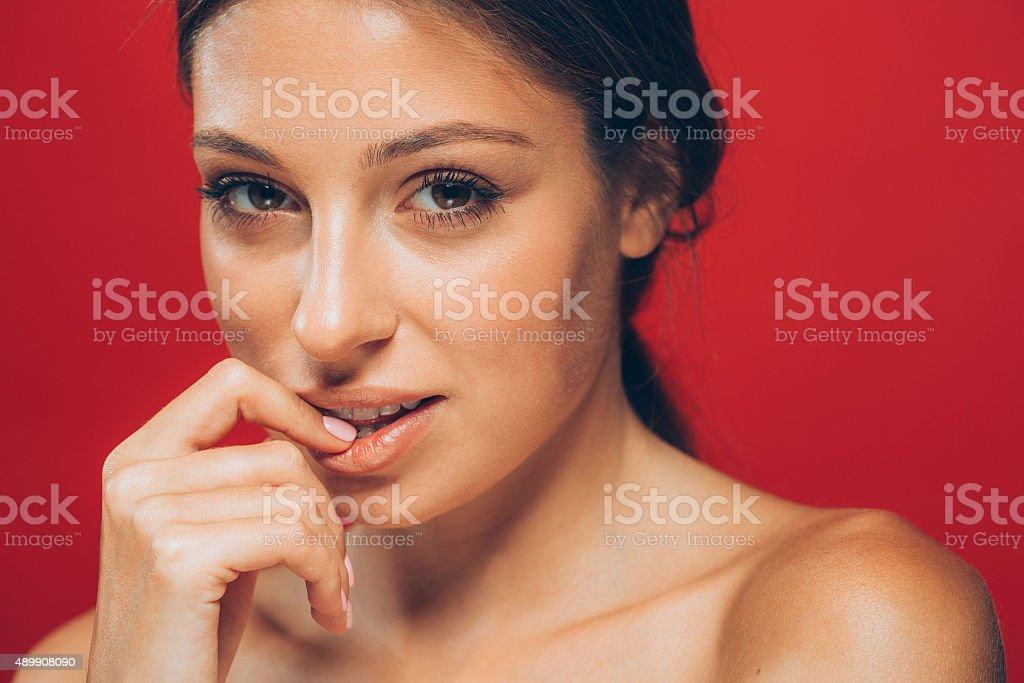 Amazing beautiful woman portrait touching lips studio stock photo