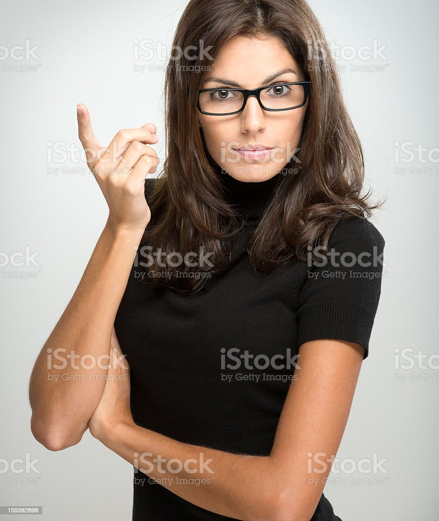 Amazing Brunette with Glasses giving a Warning (XXXL) royalty-free stock photo