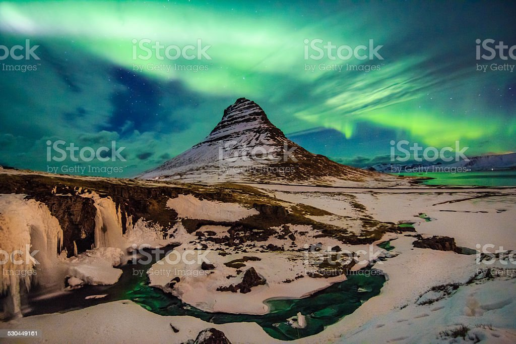 Amazing celestial lights Aurora Borealis above Kirjuffell in Iceland stock photo