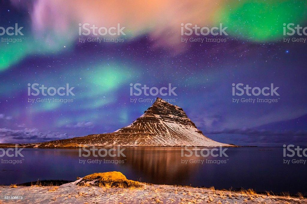 Amazing celestial lights Aurora Borealis above Kirjuffell in Iceland stock photo
