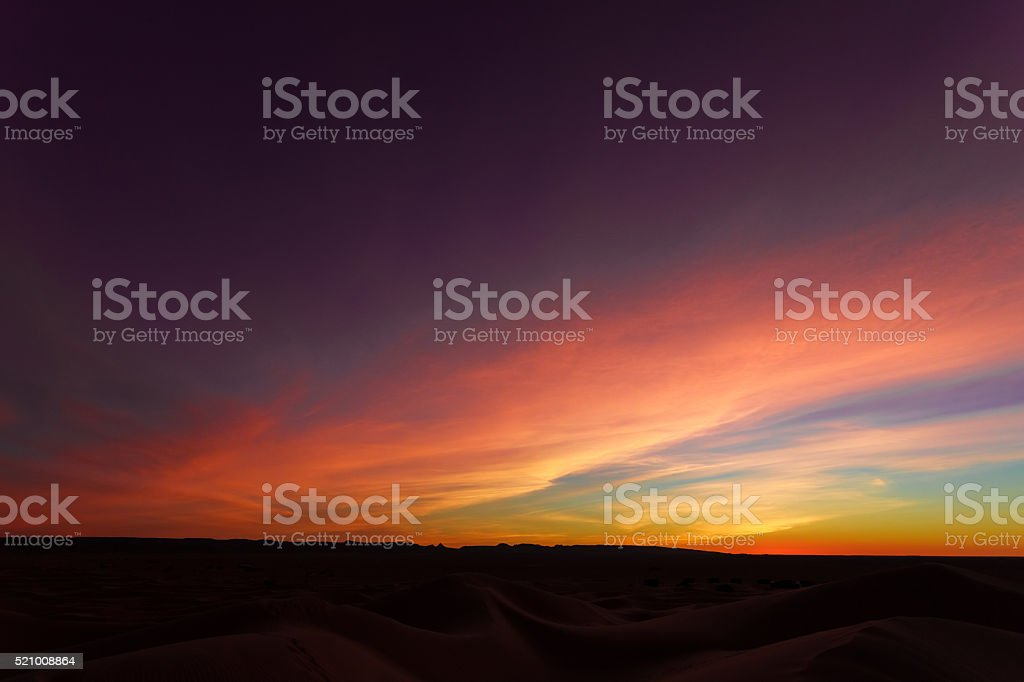 Amazing colorful sunset above the desert stock photo
