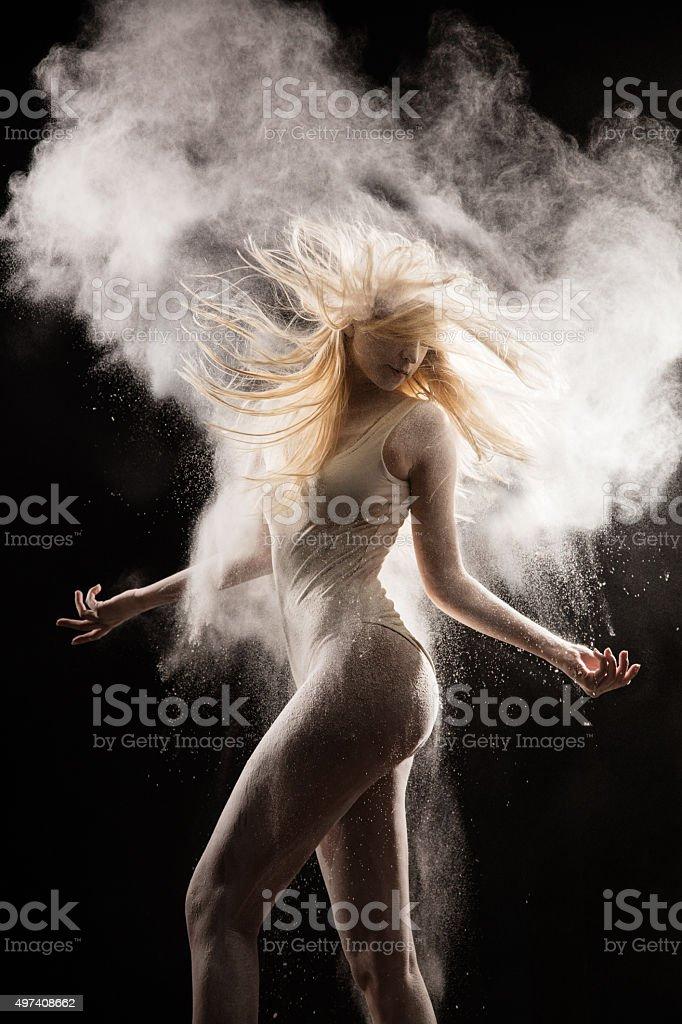 Amazing dancer dancing in powder snow stock photo