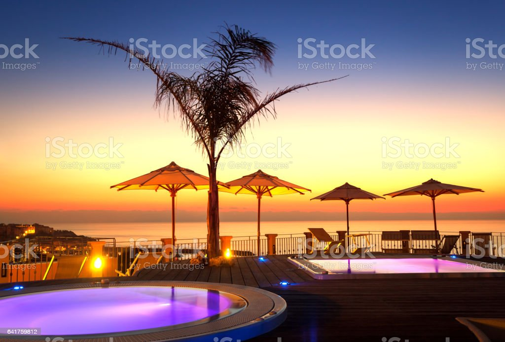 Amazing dawn as seen from luxury spa stock photo